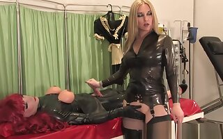 rubber skit doll made to dress as a doll with latex mistress part 2